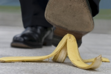 Businessman and banana skin